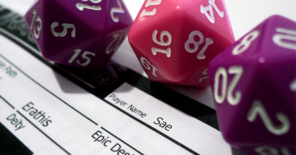 This is a photograph of three twenty sided dice, two purple and one pink, on top of a black and white Dungeons and Dragons character sheet. The photo was taken at a dramatic tilted angle to invoke the excitement of playing a tabletop role-playing game.