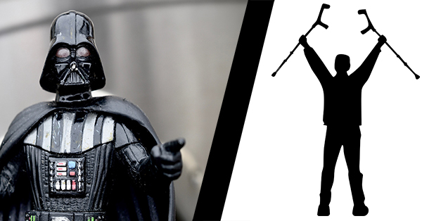 This picture illustrates two common tropes in the depiction of disability. On the left a toy Darth Vader points at the audience. On the right a silhouetted person stands, raising two crutches over their head in a triumph pose.